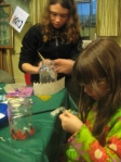 Katie helping with lantern handles