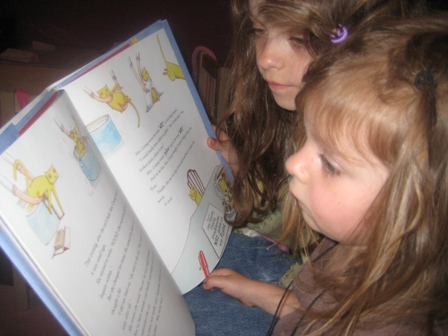 Sisters reading together.